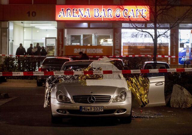 A car with dead bodies stands in front of a bar in Hanua, Germany Thursday, Feb. 20, 2020. German police say several people were shot to death in the city of Hanau on Wednesday evening