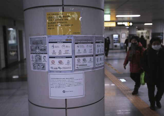 Notices about precautions against the illness COVID-19 at a subway station in Seoul