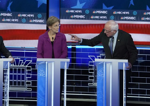 Senator Bernie Sanders (R) speaks to former New York City Mayor Michael Bloomberg (L) about the non-disclosure agreements at Bloomberg's company as Senator Elizabeth Warren listens at the ninth Democratic 2020 U.S. Presidential candidates debate at the Paris Theater in Las Vegas, Nevada, U.S., February 19, 2020.