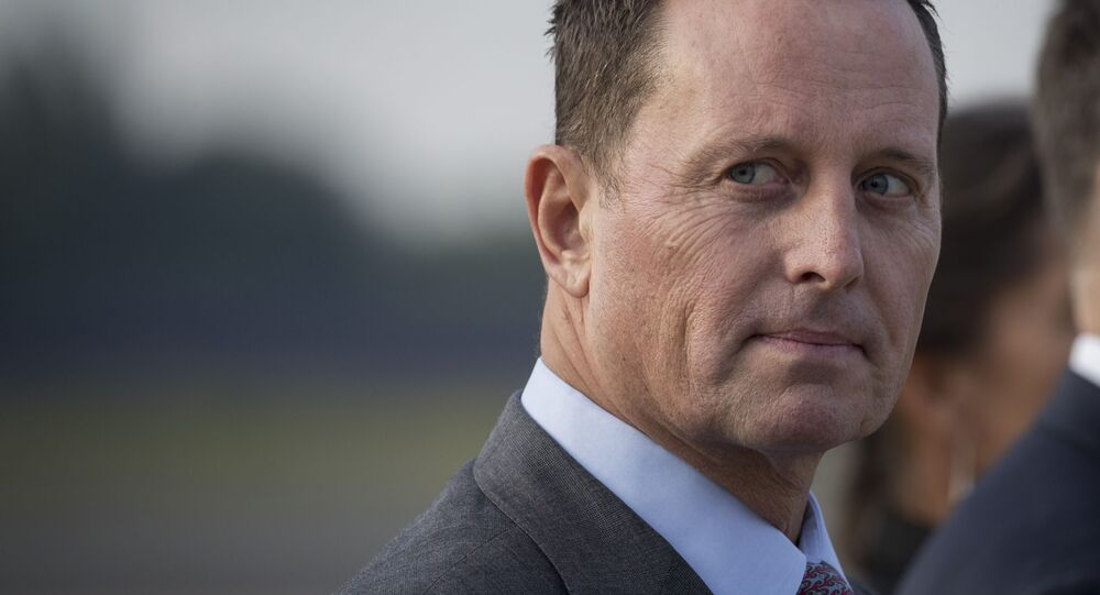 (FILES) In this file photo taken on May 31, 2019 US ambassador to Germany Richard Grenell awaits the arrival of US Secretary of State at Tegel airport in Berlin