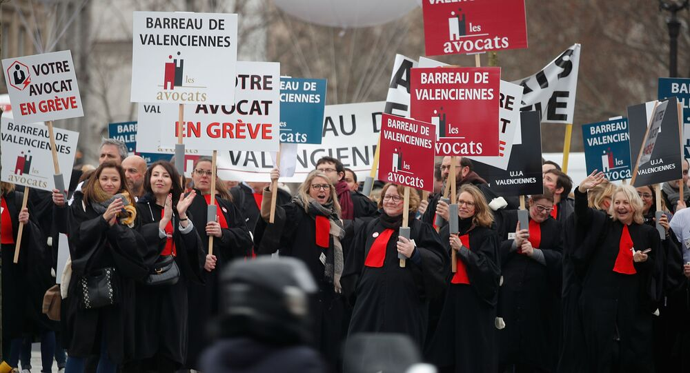 French lawyers attend a demonstration against pension reforms in Paris, France, 3 February 2020.