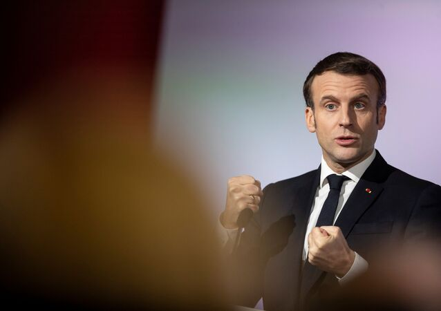 French President Emmanuel Macron gestures as he delivers a speech during a press conference