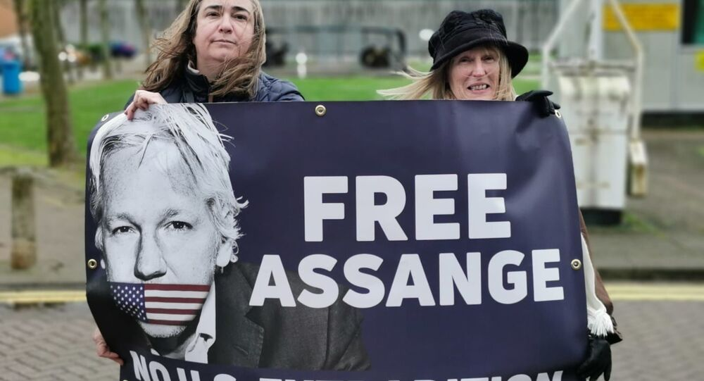 Supporters of the Committee to Defend Julian Assange Campaign stand outside HM Belmarsh Prison ahead of a presser with UK shadow chancellor John McDonnell