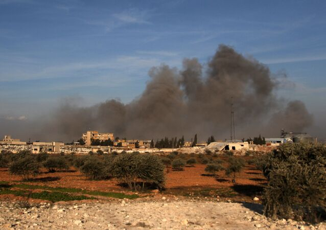 Smoke plumes rising following a reported air strike near a Turkish military observation point between the northwestern Syrian city of Idlib and the neighbouring town of Qaminas