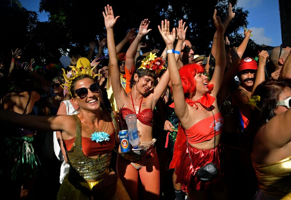Revellers take part in a street party during the annual 'Ceu Na Terra bloco', in the run-up to Rio's carnival, in Rio de Janeiro, Brazil on February 15, 2020.