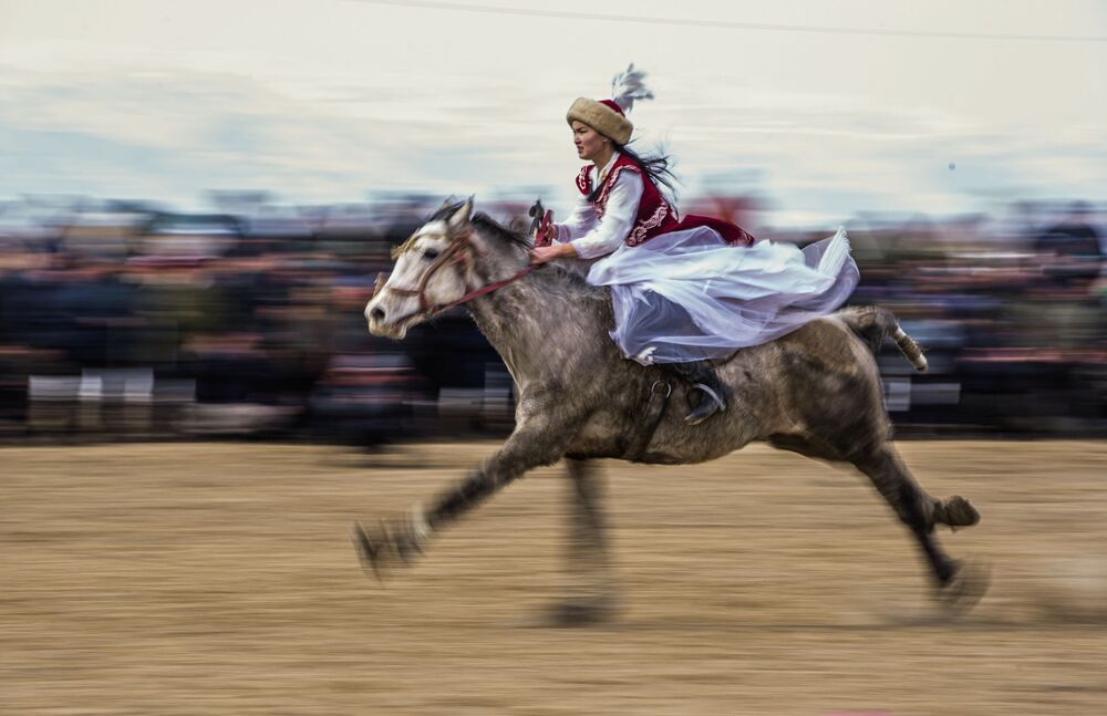 A horsewoman performs during the traditional horse game Kok-boru Championship, in the village of Kazybek, some 380 km south of the capital Bishkek, Kyrgyzstan.