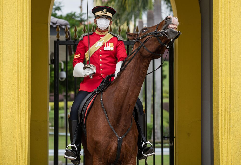 A Royal Lance Guard wears a protective facemask at the National Palace amid fears over the spread of the COVID-19 coronavirus in Kuala Lumpur on February 19, 2020.