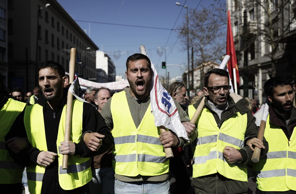 People take part in protests in Athens against a draft law on changes in social and pensions legislation