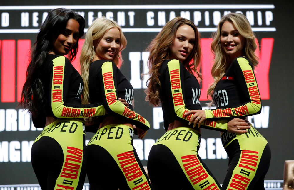 Ring girls pose ahead of the press conference held by Deontay Wilder & Tyson Fury before the Grand Garden Arena at MGM Grand, Las Vegas, United States