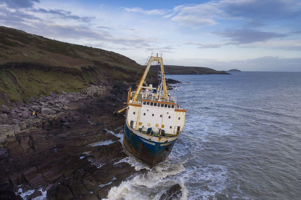 The abandoned 77-metre (250-feet) cargo ship MV Alta is pictured stuck on rocks near the village of Ballycotton south-east of Cork in Southern Ireland on February 18, 2020. - A ghost ship drifting without a crew for more than a year washed ashore on Ireland's south coast in high seas caused by Storm Dennis, the Republic's coast guard said.