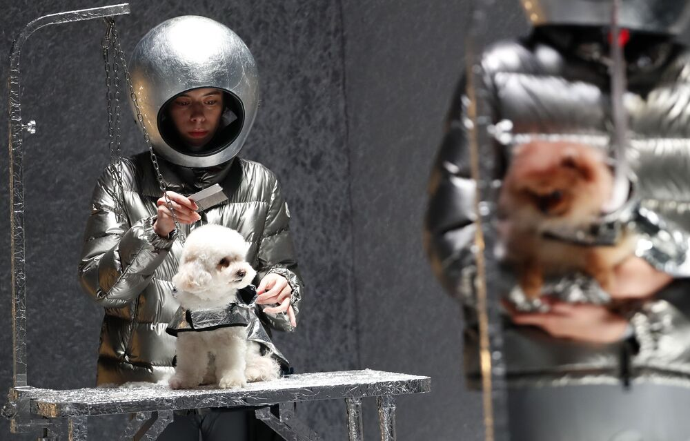 Models and dogs present creations from the Moncler Autumn/Winter 2020 collection during Milan Fashion Week in Milan, Italy February 19, 2020.