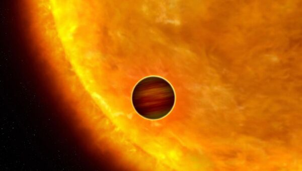 This is an artist's impression of a Jupiter-sized planet passing in front of its parent star - Sputnik International