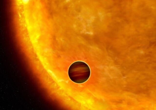 This is an artist's impression of a Jupiter-sized planet passing in front of its parent star