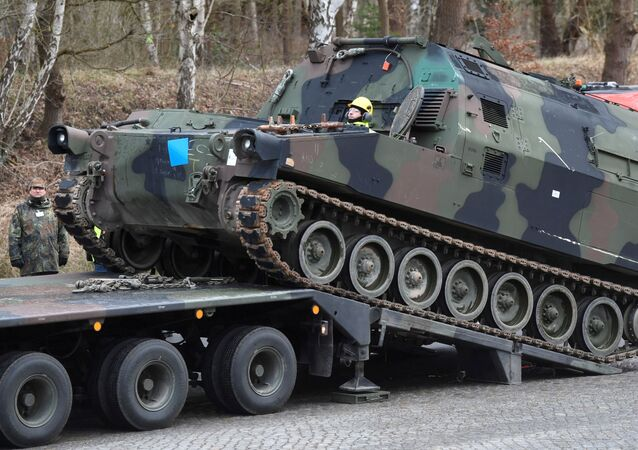 Soldiers of German Army Bundeswehr load a U.S. M992 support vehicle onto a heavy goods transporter during preparations for the Defender-Europe 20 international military exercises in Bergen Hohne, Germany, February 12, 2020