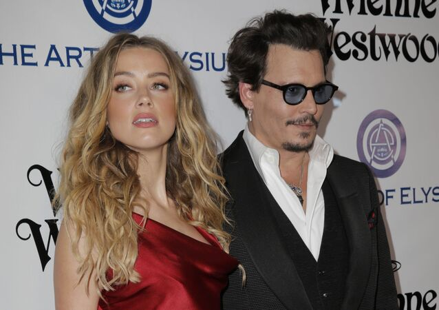 Actors Amber Heard and Johnny Depp attend The Art of Elysium 2016 HEAVEN Gala presented by Vivienne Westwood & Andreas Kronthaler at 3LABS on January 9, 2016 in Culver City, California