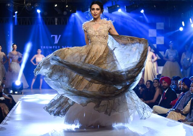In this photo taken on November 19, 2019, Bollywood actress Karisma Kapoor walks on a ramp during a fashion show at a hotel on the outskirts of Amritsar
