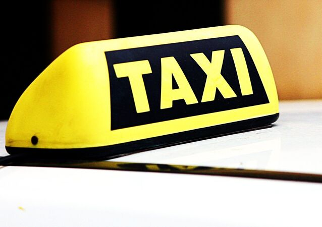 A taxi roof sign
