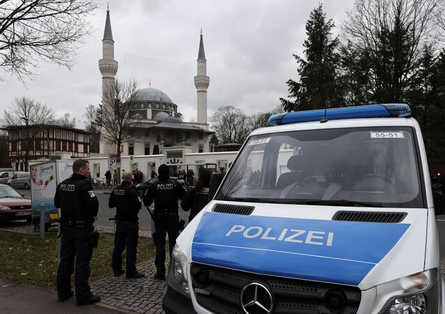 Police observe area during Friday prayer following a shooting in Hanau near Frankfurt in front of the Sehitlik Mosque in Berlin, Germany, 21 February 2020