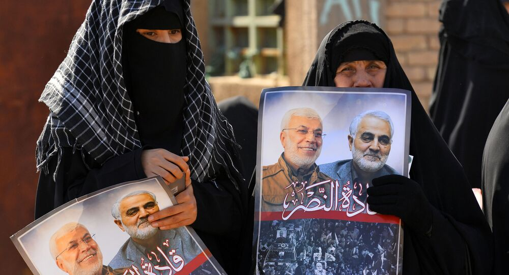Iraqi women hold portraits of Iran's late top general Qasem Soleimani (R) and Iraqi paramilitary commander Abu Mahdi al-Muhandis, killed in a US drone strike near Baghdad airport last month, during a rally called by controversial cleric Moqtada Sadr against the US' presence in Iraq and calling to separate the genders in rallies, on February 14, 2020 in the central city of Kufa