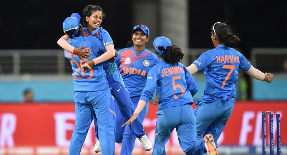India's bowler Poonam Yadav (2nd L) celebrates bowling Australia's Ellyse Perry on her first ball during the opening match of the women's Twenty20 World Cup cricket tournament at the Sydney Showground in Sydney on February 21, 2020