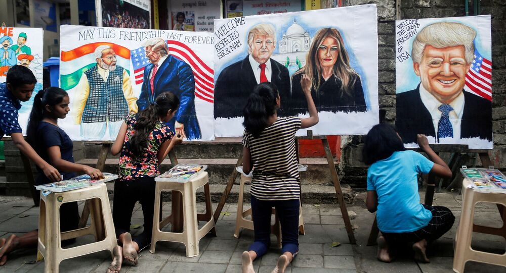 Students paint murals of US President Donald Trump and first lady Melania Trump on canvas sheets along a street in Mumbai, India, 21 February 2020