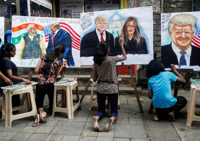 Students paint murals of U.S. President Donald Trump and first lady Melania Trump on canvas sheets along a street in Mumbai, India, February 21, 2020