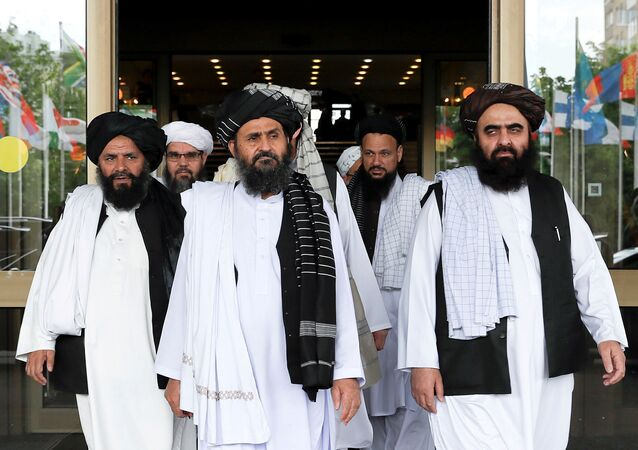 FILE PHOTO: Members of a Taliban delegation leaving after peace talks with Afghan senior politicians in Moscow, Russia May 30, 2019