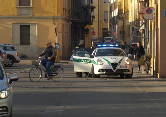 A police car is seen in the village of Codogno after officials told residents to stay home and suspend public activities as 14 cases of coronavirus are confirmed in northern Italy, in this still image taken from video in the province of Lodi, Italy, February 21, 2020