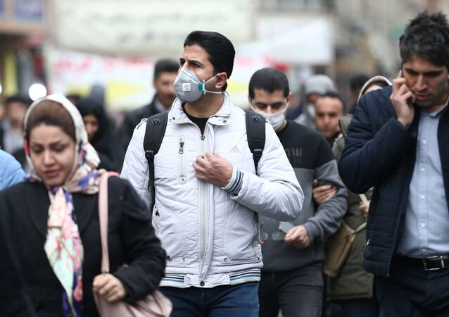 Iranian men wearing protective masks to prevent contracting a coronavirus walk at Grand Bazaar in Tehran, Iran February 20, 2020. WANA (West Asia News Agency)/Nazanin Tabatabaee via REUTERS ATTENTION EDITORS - THIS IMAGE HAS BEEN SUPPLIED BY A THIRD PARTY.