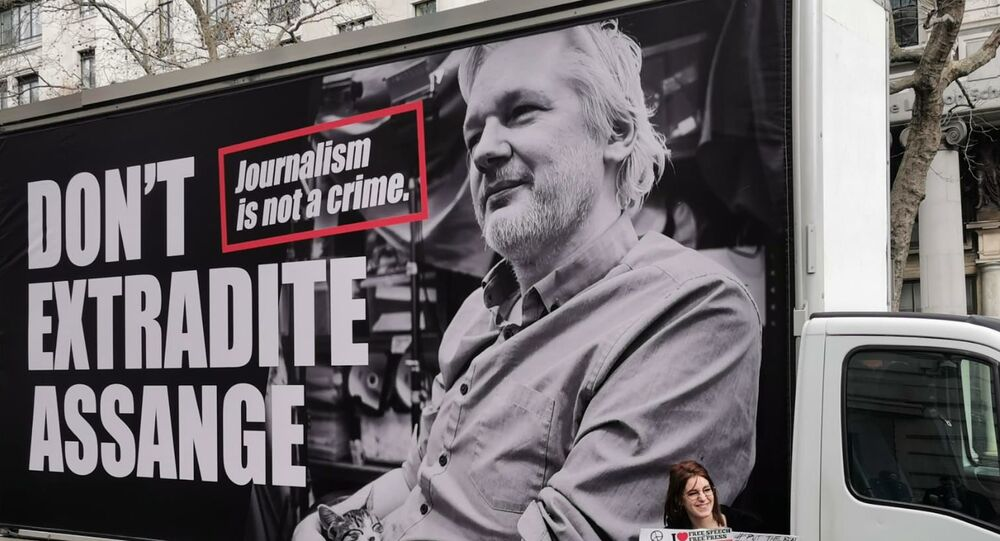 Protesters gather outside Australia House in London on Saturday for a rally in support of WikiLeaks founder Julian Assange ahead of extradition hearings.