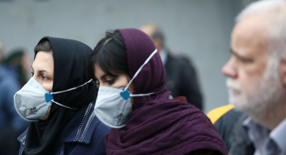 Iranian women wearing protective masks to prevent contracting a coronavirus as they walk at Grand Bazaar in Tehran, Iran February 20, 2020. WANA (West Asia News Agency)/Nazanin Tabatabaee via REUTERS ATTENTION EDITORS - THIS IMAGE HAS BEEN SUPPLIED BY A THIRD PARTY.