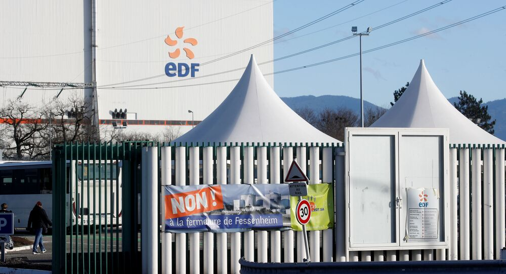 A banner is seen on a fence at France's oldest Electricite de France (EDF) nuclear power plant near the eastern French village of Fessenheim, France February 20, 2020. The banner reads: No! To closing Fessenheim.