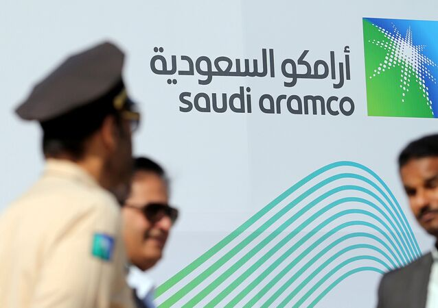 The logo of Aramco is seen as security personnel stand before the start of a press conference by Aramco at the Plaza Conference Center in Dhahran, Saudi Arabia November 3, 2019