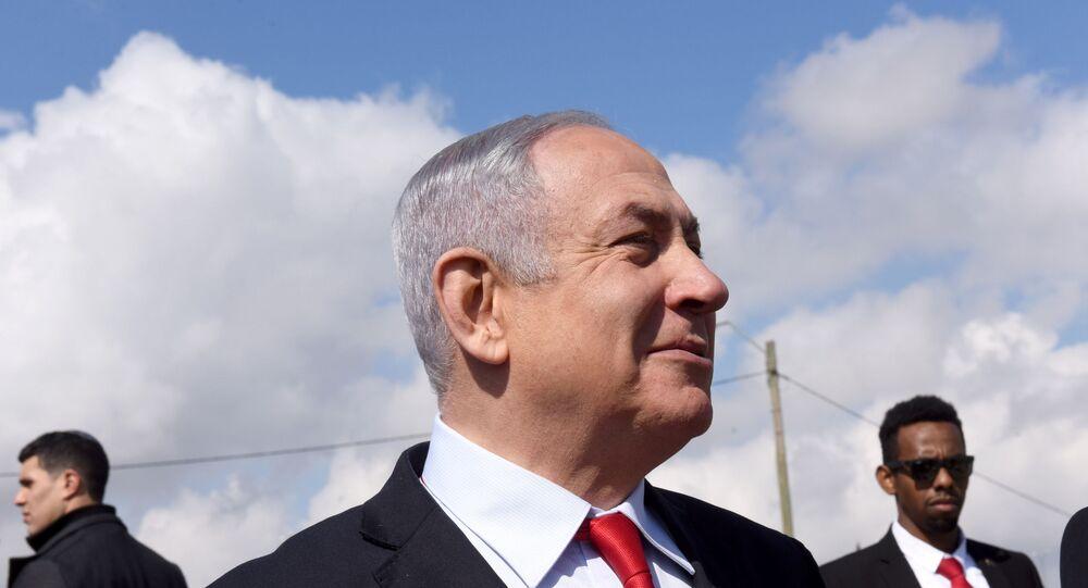 Israeli Prime Minister Benjamin Netanyahu near the Israeli settlement of Har Homa