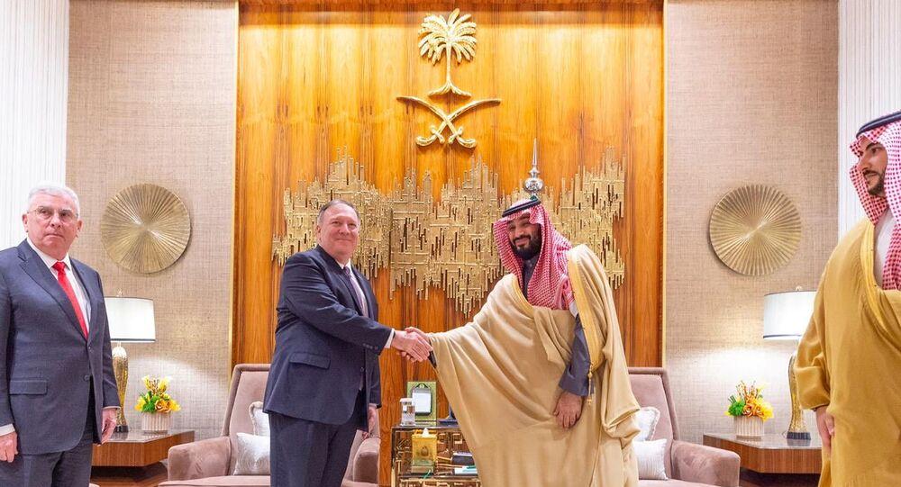 Saudi Arabia's Crown Prince Mohammed bin Salman shakes hands with US Secretary of State Mike Pompeo in Riyadh, Saudi Arabia 20 February 2020. Bandar Algaloud/Courtesy of Saudi Royal Court/