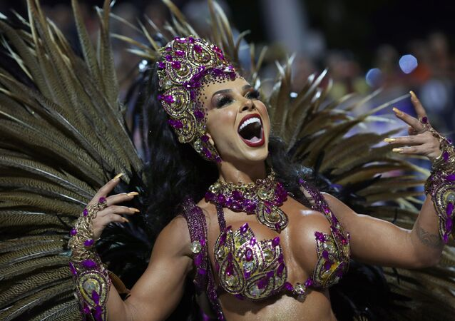 A Reveller from Barroca Zona Sul samba school performs during the first night of the Carnival parade at the Sambadrome in Sao Paulo, Brazil, February 21, 2020.