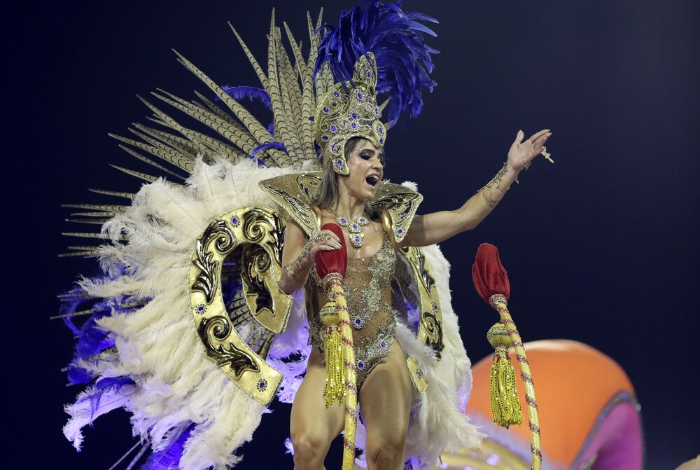 A dancer from the Tom Maior samba school performs on a float during a carnival parade in Sao Paulo early Saturday, Feb. 22, 2020.