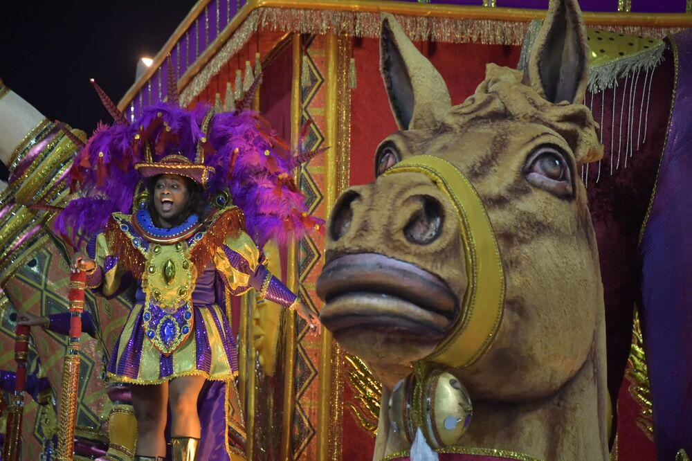 A reveller of the Barroca Zona Sul samba school performs during the first night of carnival in Sao Paulo Brazil at the city's Sambadrome in the early hours of February 22, 2020.