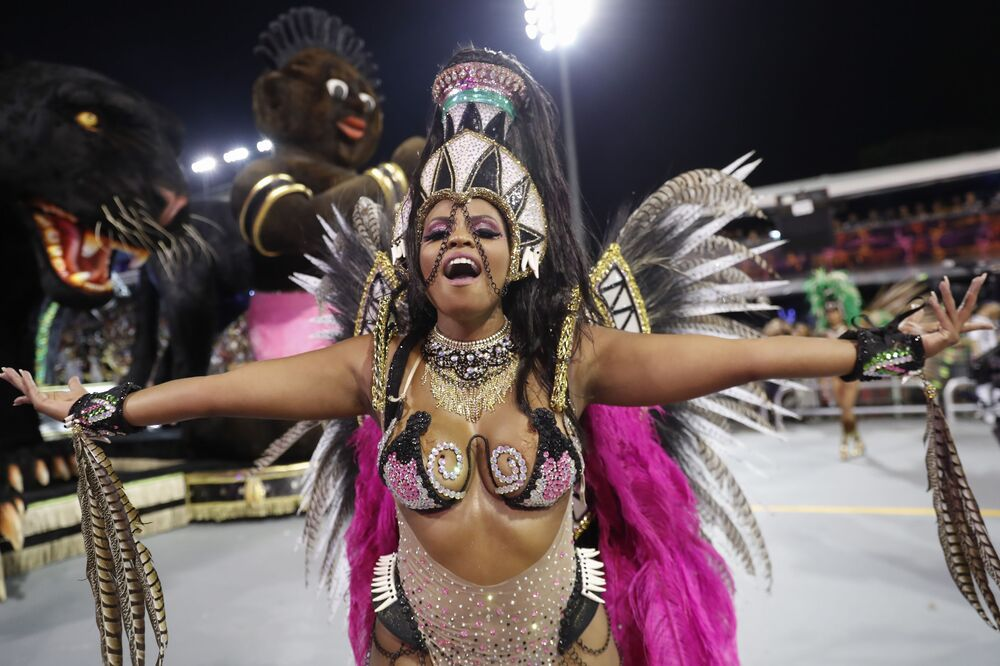 A dancer from the Barroca Zona Sul samba school performs during a carnival parade in Sao Paulo, Brazil, Friday, Feb. 21, 2020.