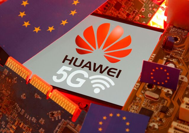 The EU flag and a smartphone with the Huawei and 5G network logo are seen on a PC motherboard in this illustration taken January 29, 2020.