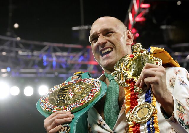 Tyson Fury poses with his belts during a press conference after the fight with Deontay Wilder for the WBC heavyweight title at the Grand Garden Arena at MGM Grand, Las Vegas, United States, February 22, 2020