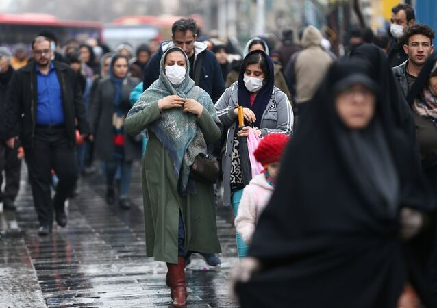 Iranian women wear protective masks to prevent contracting a coronavirus, as they walk at Grand Bazaar in Tehran, Iran February 20, 2020.