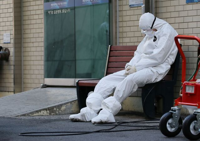 A medical worker takes a rest outside a hospital in Daegu, South Korea, February 23, 2020