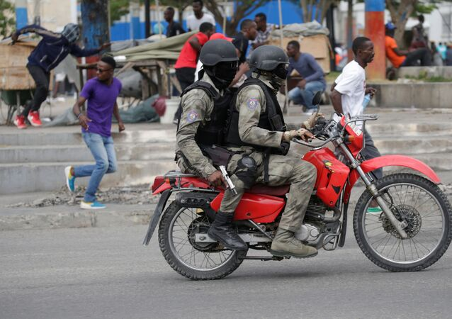 Protesters and masked men in Haitian National Police uniforms during a shooting in Champ de Mars, Port-au-Prince, Haiti