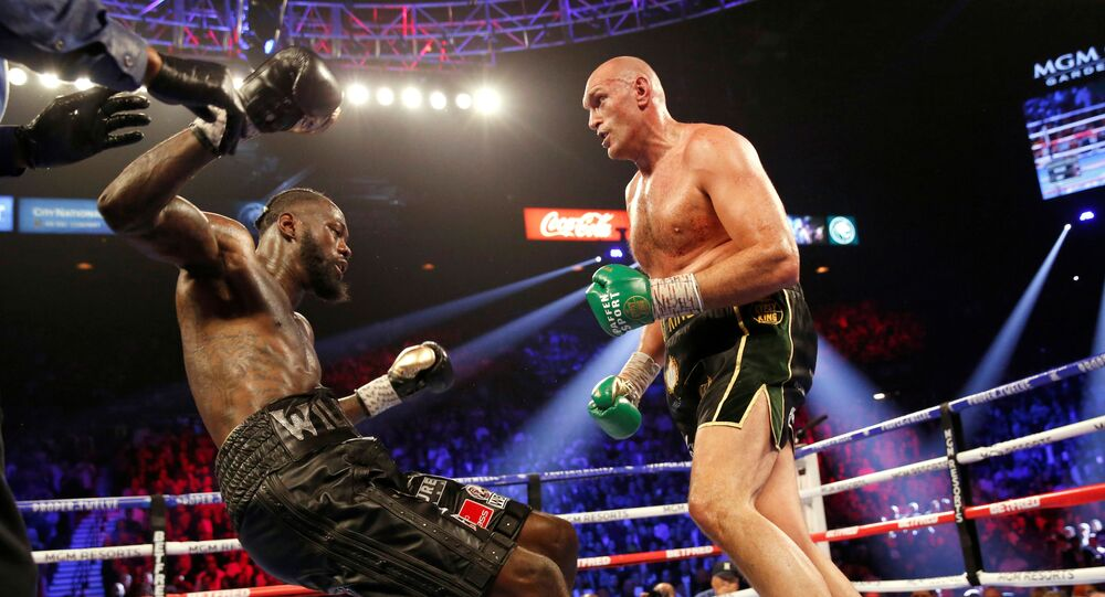 Tyson Fury knocks down Deontay Wilder in the third round during the pair's second fight, in Las Vegas