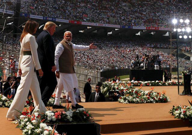 US President Donald Trump, his wife and Indian Prime Minister Narendra Modi arrive at Sardar Patel Gujarat Stadium in Ahmedabad