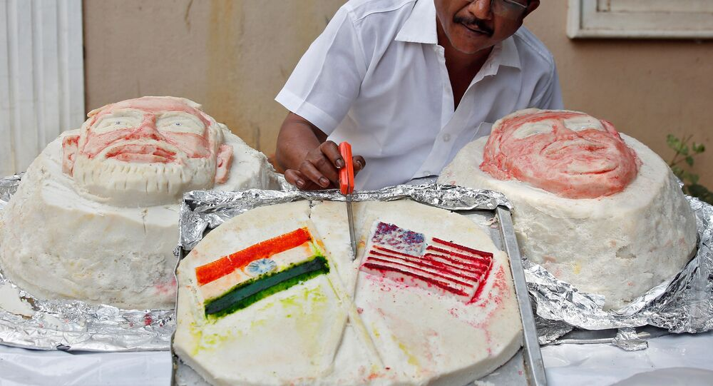 Chef Iniavan applies finishing touches to Idli, a rice cake, made by him in the shapes of U.S. Donald Trump, Indian Prime Minister Narendra Modi and U.S. and Indian flags to welcome him to India