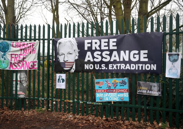 Posters of support hang outside Woolwich Crown Court, ahead of a hearing to decide whether WikiLeaks founder Julian Assange should be extradited to the United States, in London, Britain, 24 February 2020.