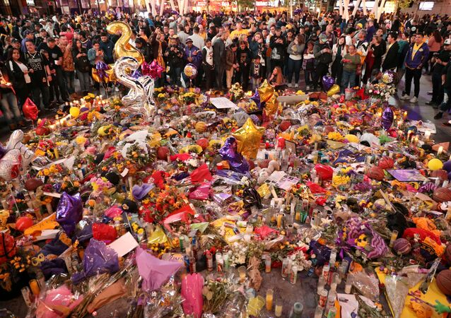 Mourners gather outside Staples Center before a Los Angeles Lakers home game to pay respects to Kobe Bryant after a helicopter crash killed the retired basketball star and his daughter Gianna, in Los Angeles, California, U.S., January 31, 2020.