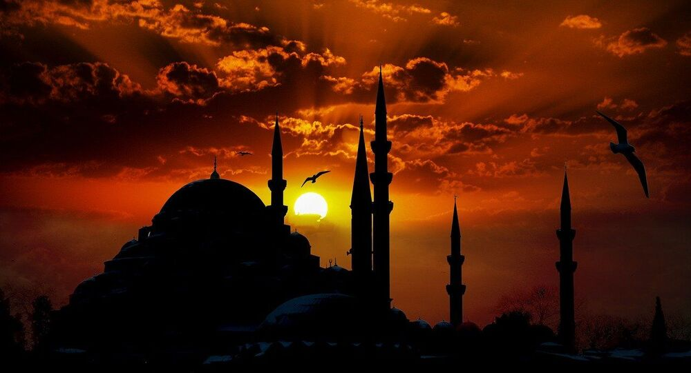 Mosque is seen with a sunset on the background